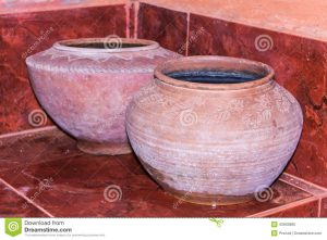 Two clay pots for storing drinking water.